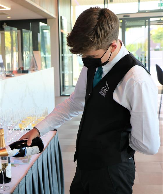 Aspects Event Staff pouring sparkling wine